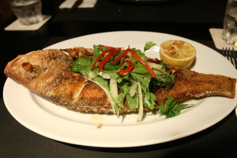 Whole roasted snapper with herb salad and lemon jam