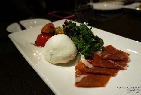 Delicious burrata cheese, roasted tomatoes, rocket and Parma ham