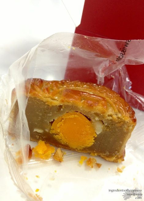 A close-up of the Szechuan Court Single Yolk with Macadamia nuts baked mooncake