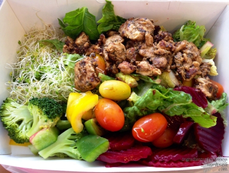 Assorted salad with Cajun Chicken in a takeaway box