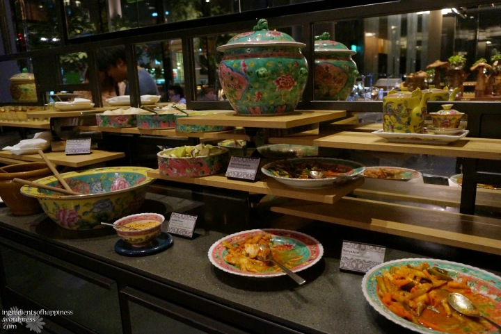 The Asian appetizers (like rojak) and desserts displayed nicely on a counter